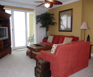Beach Daze at Emerald Isle on Panama City Beach Living room with love seat and couch that opens into a pull out bed