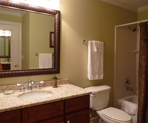 Beach Daze at Emerald Isle on Panama City Beach Master bath with granite counter top and decorative Mirror